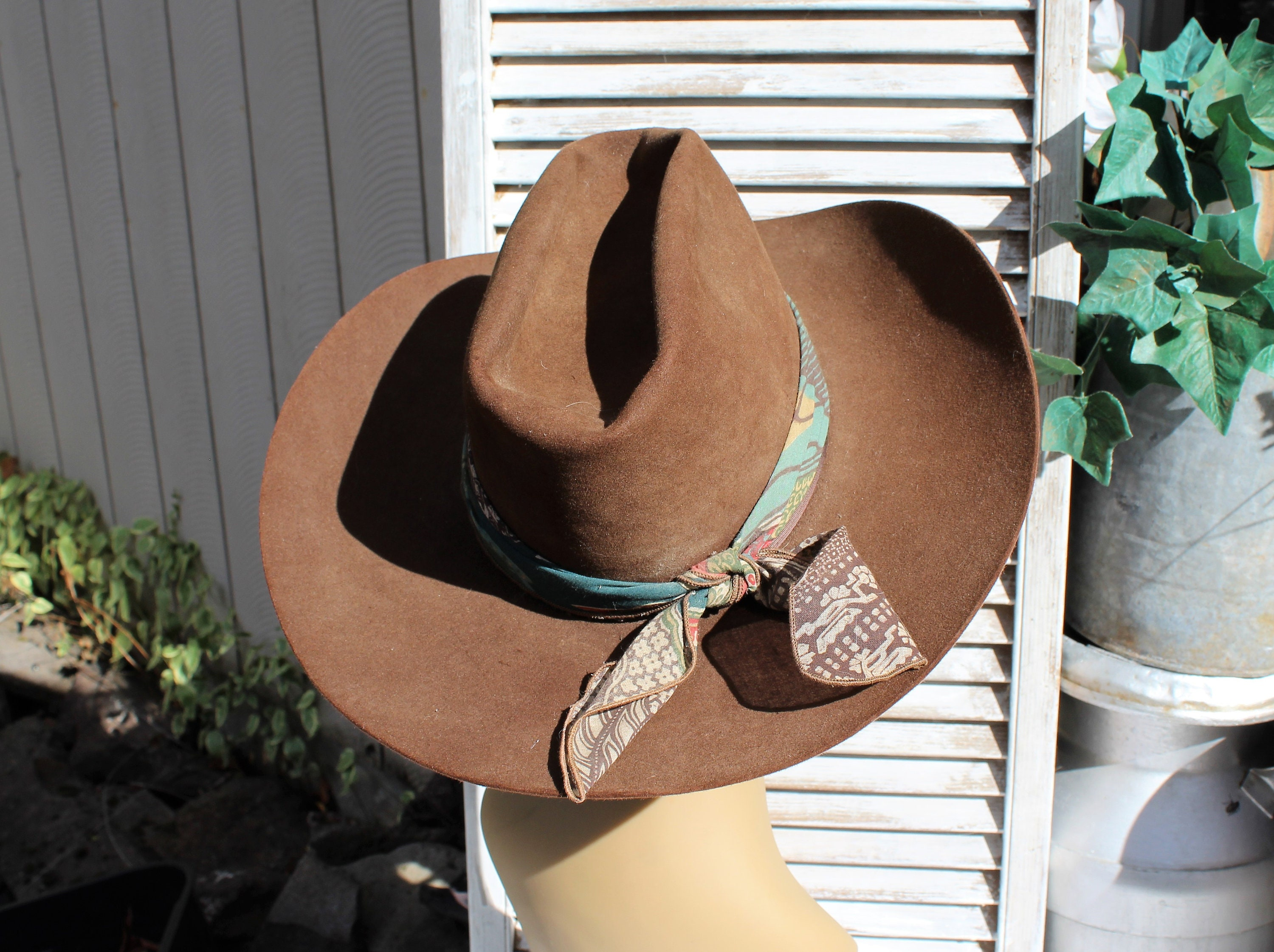 eacf9eb7466 Vintage brown mens cowboy western hat with scarf attached.