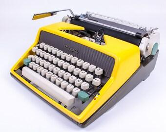 BEST GIFT! Typewriter.Company Yellow Olympia Monica SM7- working typewriter -  gift - portable typewriter sale