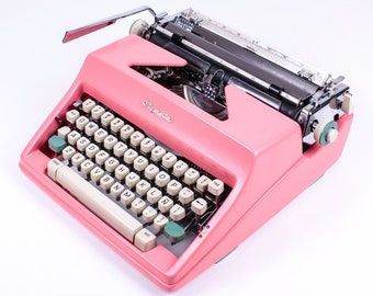 Typewriter.Company - The Best Working typewriter - Olympia  SM - vintage working typewriter - pink typewriter - qwerty