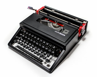 SALE OLIVETTI DORA black mint condition perfectly working vintage typewriter - Professionally Serviced by Typewriter.Company