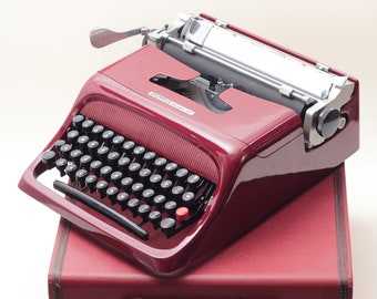 EXCLUSIVE OLIVETTI STUDIO 44 merlot mint condition perfectly working vintage typewriter - Professionally Serviced