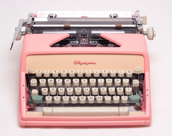 CUSTOM-MADE Pink Olympia Monica SM7 Manual and portable working typewriter with qwerty layout- Refurbished
