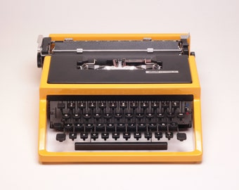 CUSTOM MADE yellow/black OLIVETTI Dora aka Lettera 31- highly durable car paint -portable typewriter- rare typewriter- mint condition
