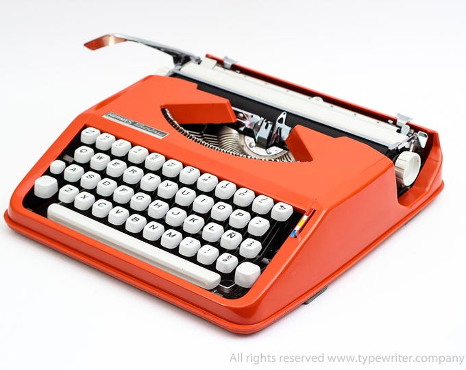 Typewriter.Company - HERMES Baby typewriter - techno qwerty font - orange portable -working typewriter - 1970s manual vintage