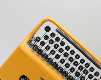 BEST GIFT! Typewriter Olivetti Pluma 22 - working portable typewriter - yellow typewriter - qwerty keyboard - typewriter.company