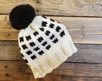 Adult black and white hand knit fair isle pom hat
