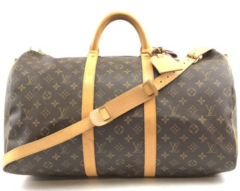 c2596f2ea0c9 Louis Vuitton Keepall with Strap 50 Bandouliere Duffel Monogram Coated  Canvas Weekend Travel Bag