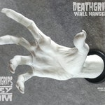 White WITCH DEATHGRIPS™ Wall Hanger for guitars and other items. By Gabe Escamilla Right Hand Wall-Mount Display