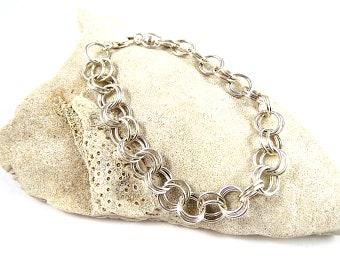 Sterling Silver Bracelet Simple But Elegant .925 Sterling Silver Chain Bracelet with sterling silver parot clasp. Great gift