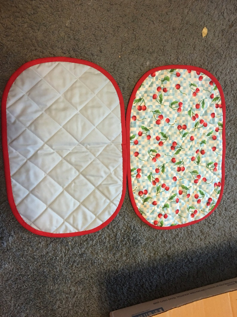 sets of 2 Hand and machine quilted cheery and blue plaid placemats and pot holders with red trim