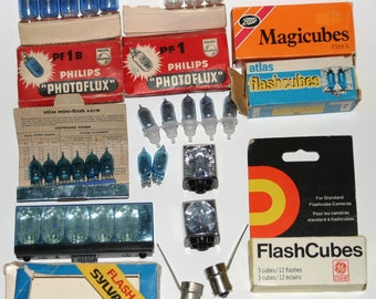 Large lot of camera flash bulbs and flash cubes