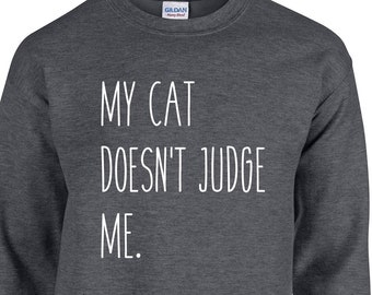 My Cat Doesn't Judge Me - Cat Sweatshirt - A comfy sweatshirt for animal lovers