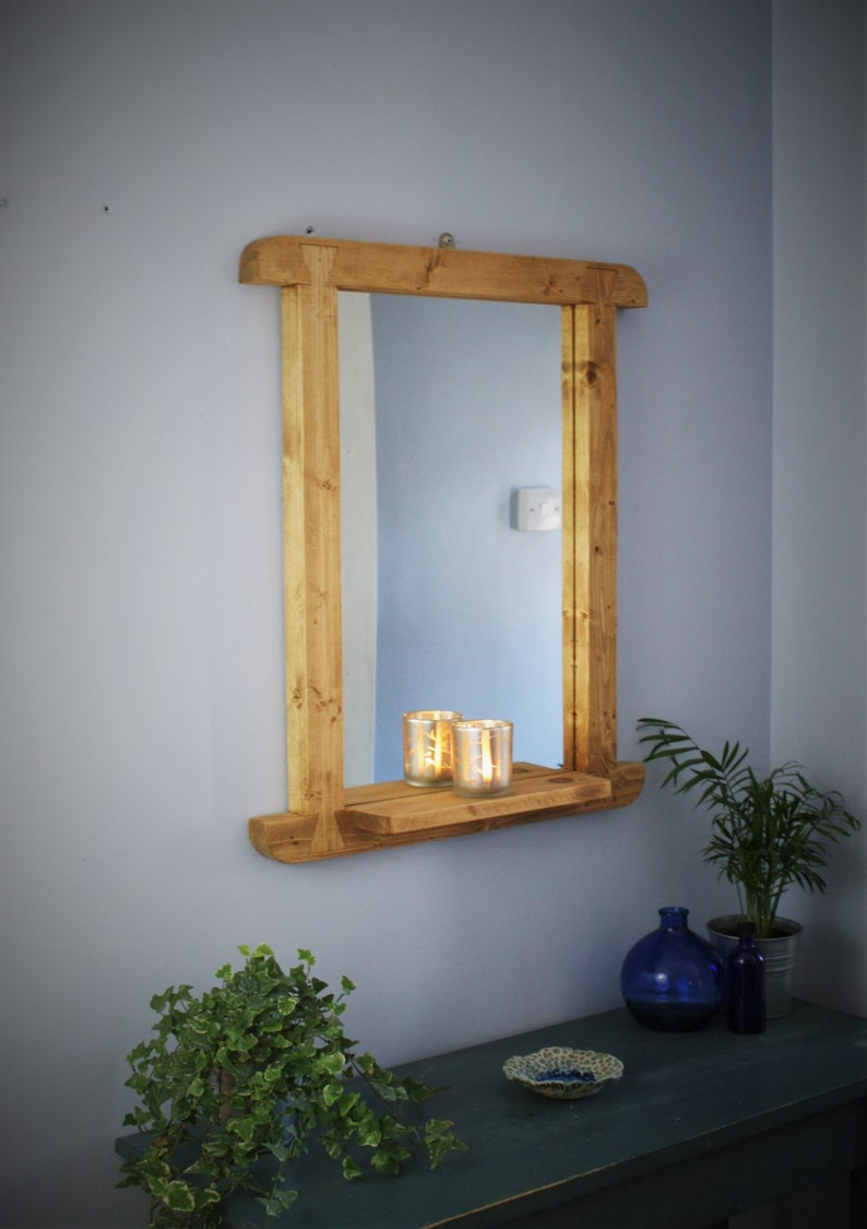 wooden wall mirror with shelf rustic light wood thick curved image 0
