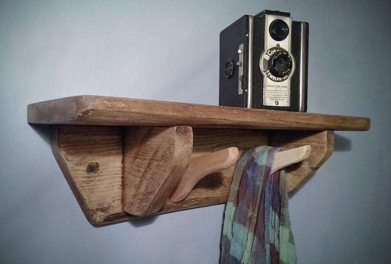 wooden shelf with hooks 2 wooden hanger coat hooks set below image 0