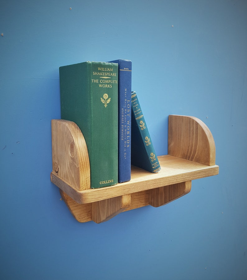 small wooden wall shelf with book ends and wood brackets 44 cm image 0