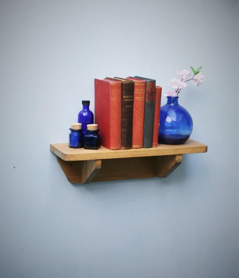 small wood shelf natural light wood bookshelf with brackets image 0