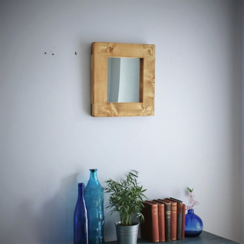 wooden wall mirror thick wood frame in light natural wood 33 image 0