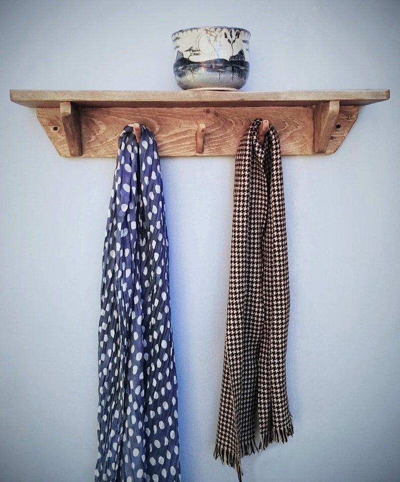 Chunky wooden wall shelf with hooks light natural wood 3 image 0