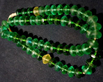 African Trade Bohemian green vaseline glass beads, 24 inch strand, 11x15 mm beads. Plump beads glow in black light. (#93)