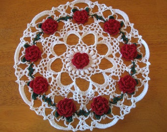 New white hand-crocheted doily with red roses