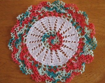 New small white, coral, and green hand-crocheted doily