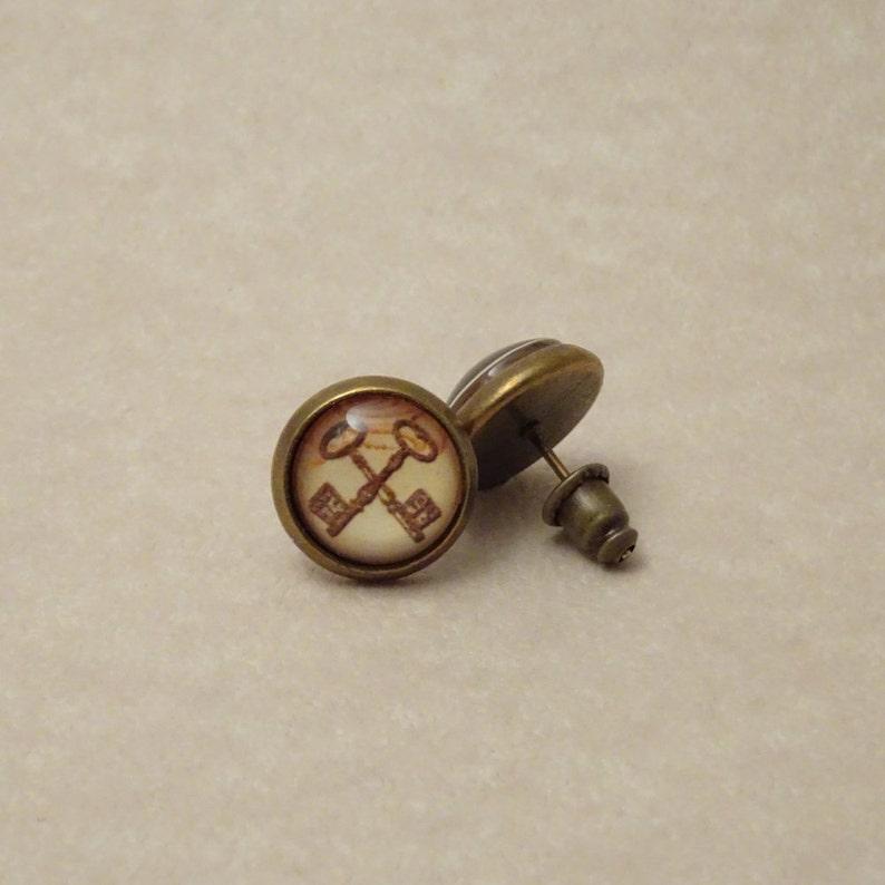 ba89214c2 10mm Steampunk Key Earring Studs Crossed Keys Set in Glass | Etsy