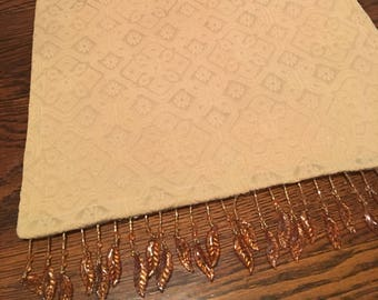"""Antique gold matelasse table runner with beaded trim, 34"""" x 13 1/2"""""""