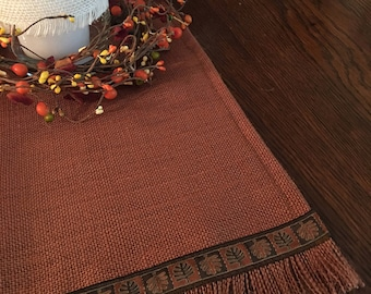 Terra cotta burlap table runner with jacquard ribbon trim in various sizes