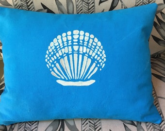 Small throw pillow made with turquoise canvas duck cloth with shell stencil, 12x16""