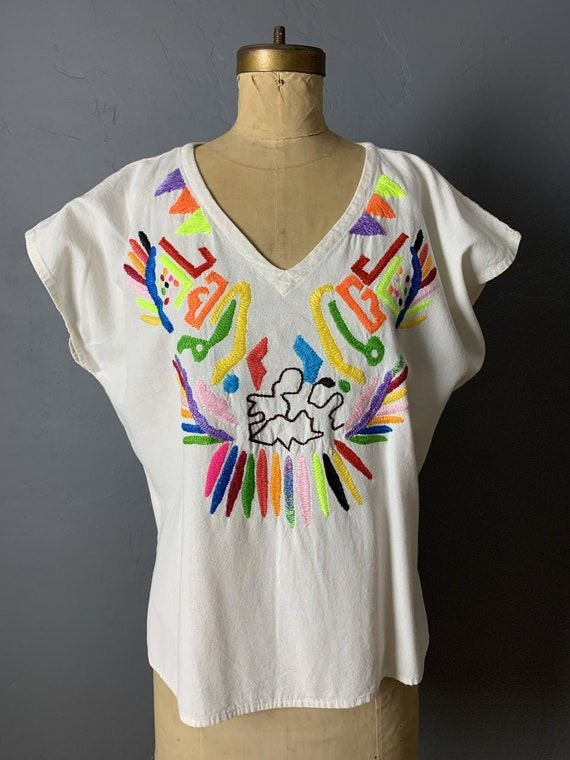 Abstract embroidered top