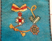 Petit-point and needlepoint military medal theme pillow