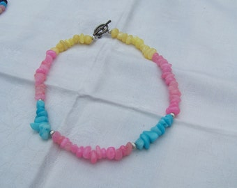 Turquoise , pink and yellow jelly bean necklace.