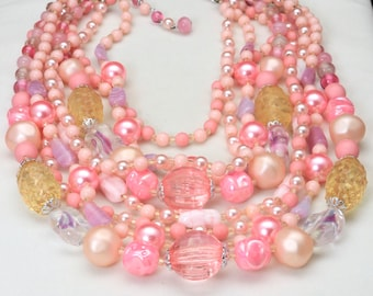 Vintage Eight Strand Multi Shade Pink Beaded Bombshell Necklace Glass