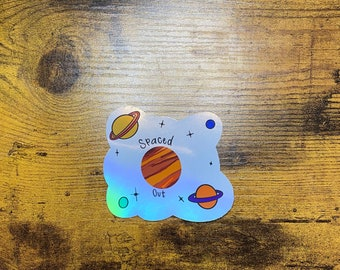 Spaced out holographic sticker