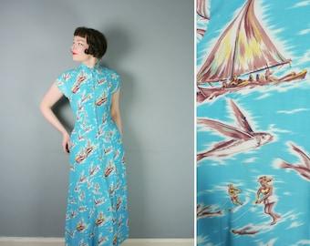 50s HAWAIIAN long dress in light blue with NOVELTY surfer girl and flying FISH print - Tiki Pake Muu style dress - xs