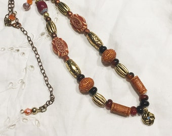 Primitive  brown and orange golf ball marker necklace