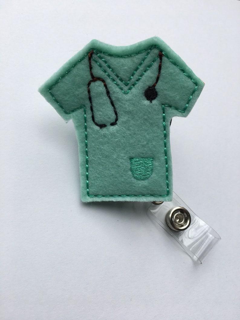 Medical professional turquoise scrubs badge reel  nurse image 0