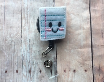 Notebook paper with smiling face badge reel -- perfect gift for your favorite teacher, para, tutor, or aide -- show your appreciation