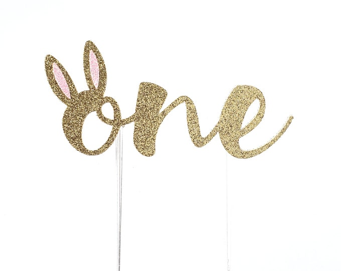 Featured listing image: Bunny First Birthday Cake Topper – Some Bunny is One Theme Party – First Birthday Party – Bunny Birthday Décor – Easter Party Decor