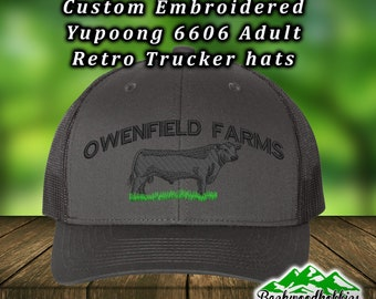 6ee6ff27fce Embroidered Yupoong 6606 trucker hats with black angus bull