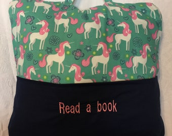 Bedtime/Travel Pillow  Unicorn  Holds a book in one pocket/and IPad or travel game in the other pocket