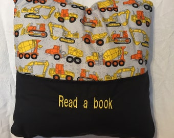 Bedtime/Travel Pillow Construction Trucks  Holds a book in one pocket/and IPad or travel game in the other pocket
