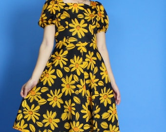 1960s. black and orange. daisy dress. with puff sleeves and high waist skirt. small