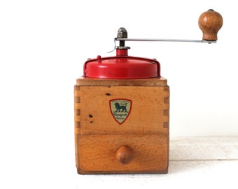 Vintage wooden Peugeot Coffee Mill with red metal top. 1950s