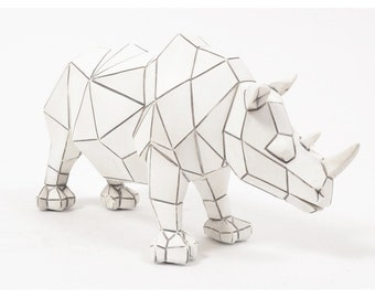 Origami rhinoceros statue in white and black resin, length 10'2 inches