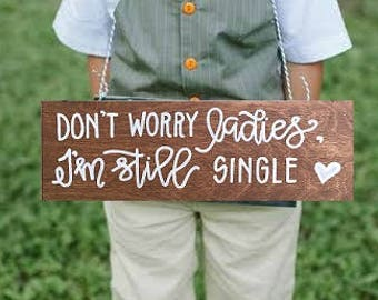 i'm still single sign / don't worry ladies / daddy here comes mommy / i'm only here for the cake sign / ring bearer sign / aisle sign.