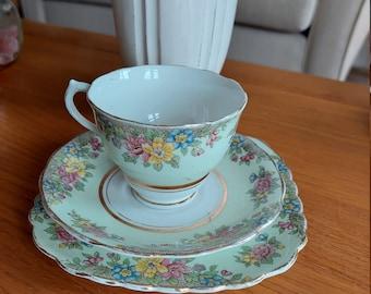 Colclough trio tea set. Made In England bone china. Green floral.