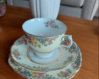 Colclough trio tea set. Made In England bone china. Yellow floral.