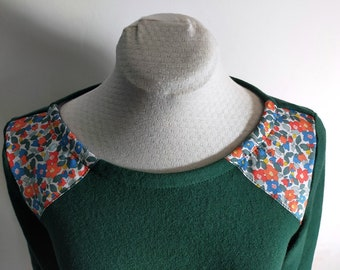 dark green and floral liberty sweater in orange, blue and green at the shoulders