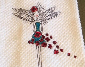 Beautiful Blue Dress Fairy with Red Roses falling to the side.  Dainty wings adorn this Hand Towel .